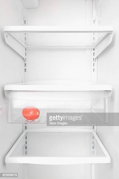 tomato in a refrigerator - empty fridge stock pictures, royalty-free photos & images