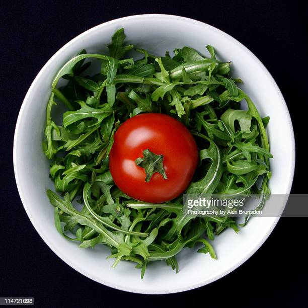 Tomato in bowl of Rocket Leaves