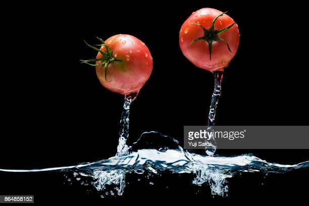 Tomato jump out from water.