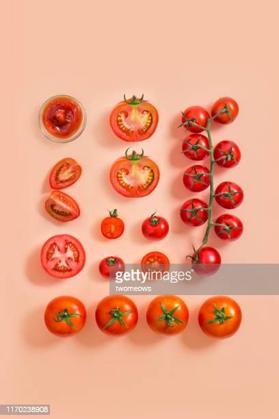 tomato on coloured background. - トマト ストックフォトと画像