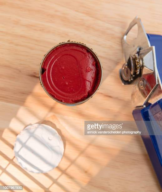 Tomato paste food can and can opener.
