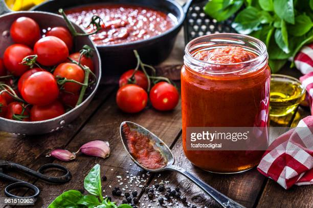 tomato sauce - marinara stock photos and pictures