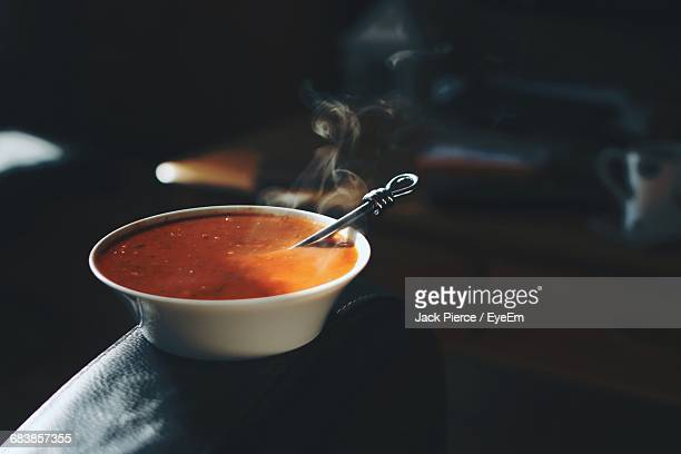 Tomato Soup In Bowl On Sofa At Home