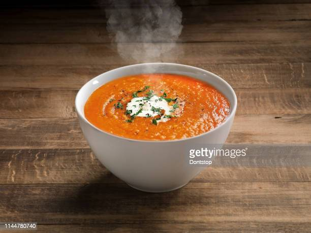 tomato soup on wooden table background. - soup stock pictures, royalty-free photos & images