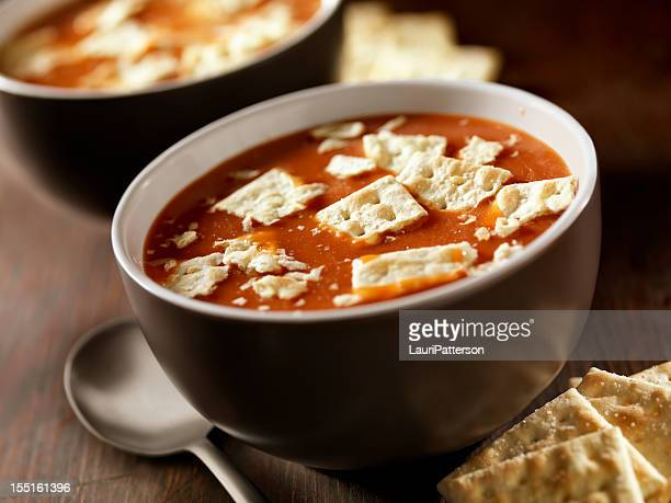 tomato soup with crackers - tomato soup stock photos and pictures