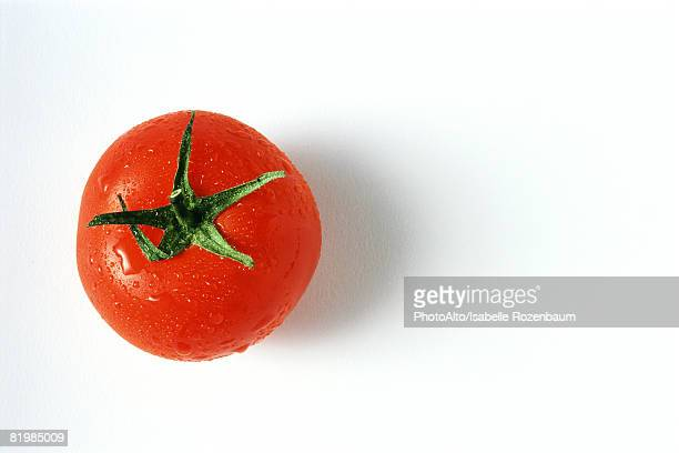 Tomato with droplets of water, close-up, viewed from directly above