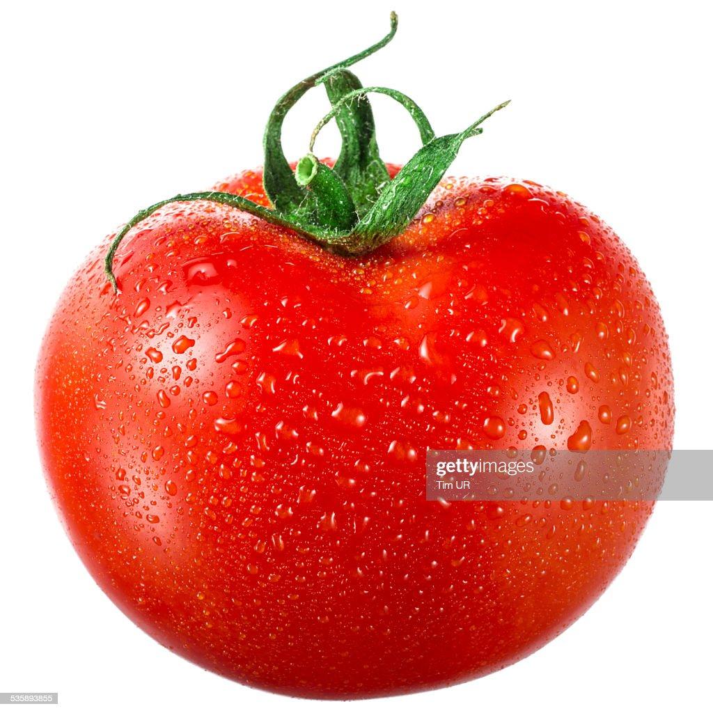 トマトの滴白背景 : ストックフォト