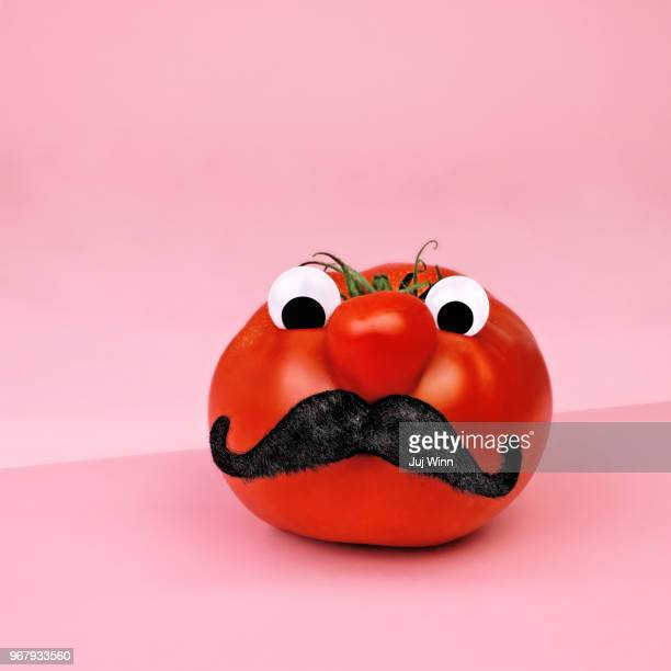 Tomato with eyes and mustache