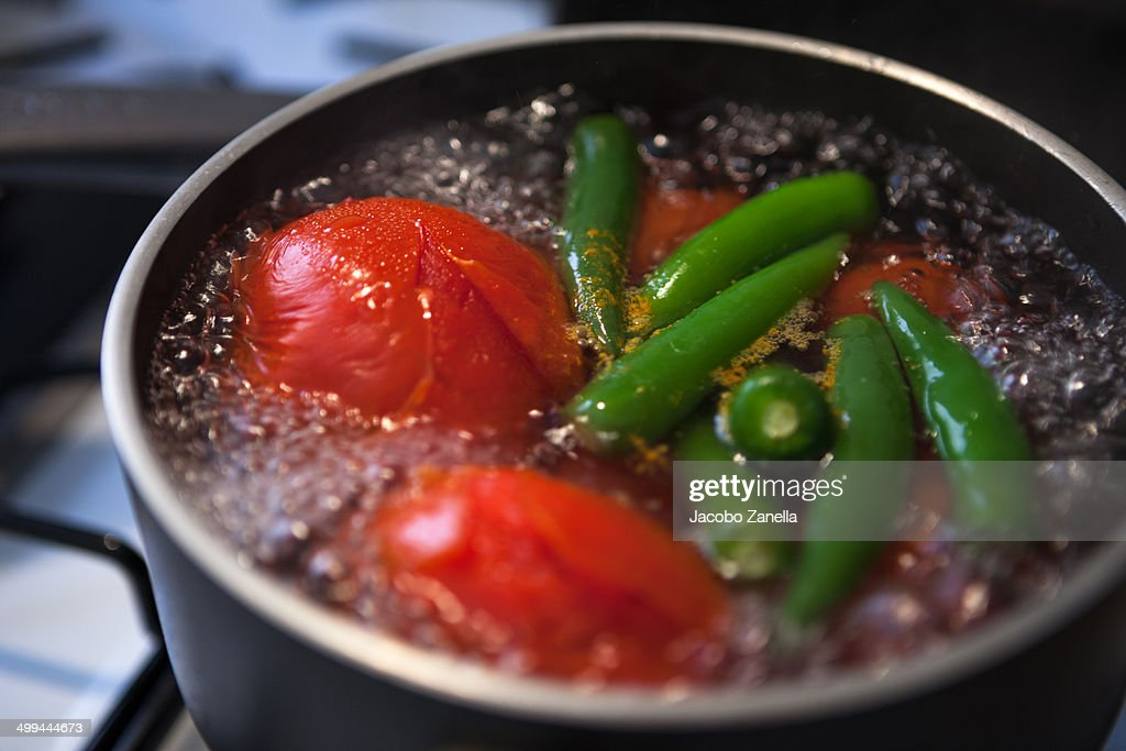 Tomatoes And Chili Peppers Being Boiled High Res Stock Photo Getty Images