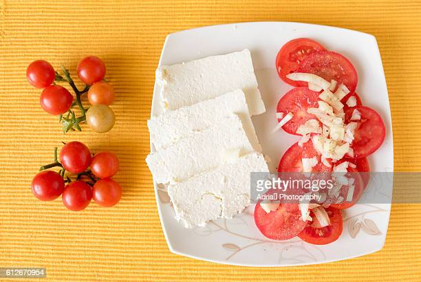 Tomatoes and white cheese