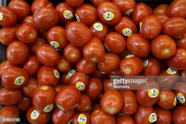 Tomatoes are displayed for sale during the grand opening of a Whole Foods Market 365 location in Santa Monica California US on Wednesday Aug 9 2017...
