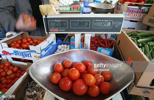 Tomatoes are weighed at Inverness market on March 24 2009 in London England Imported goods such as fruit and vegetables have caused an expected rise...