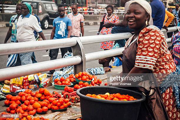 Tomatoes for sale on the bridge in Lagos, Nigeria.