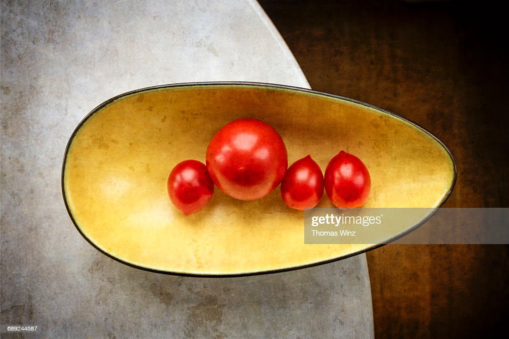 Tomatoes in a bowl : Stock Photo