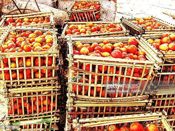 Tomatoes In Basket For Sale At Market Stall
