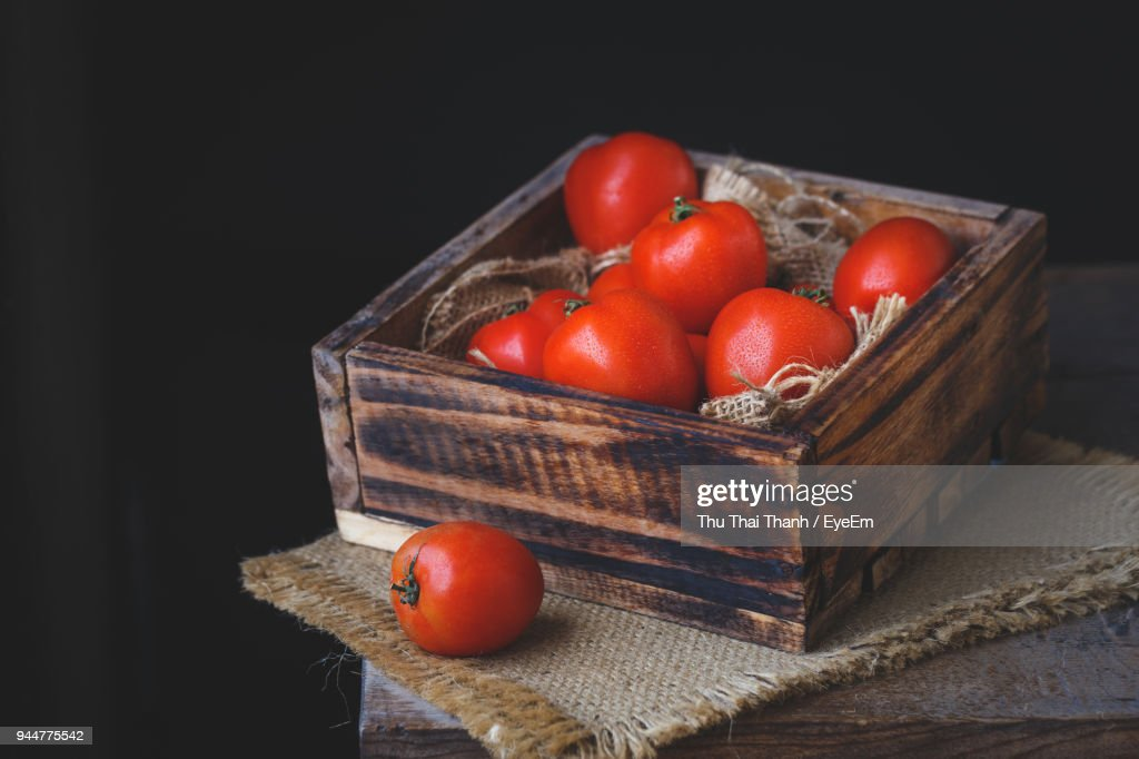Tomatoes In Wooden Container On Table : Stock Photo