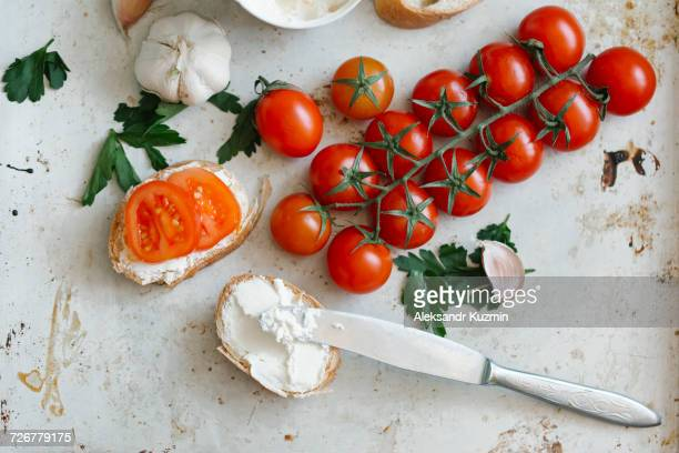 tomatoes on vine near cream cheese and bread - spreading stock pictures, royalty-free photos & images