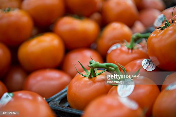 Tomatoes sit on display for sale in a supermarket in Princeton Illinois US on Wednesday July 2 2014 Rising prices for beef ice cream and lettuce mean...