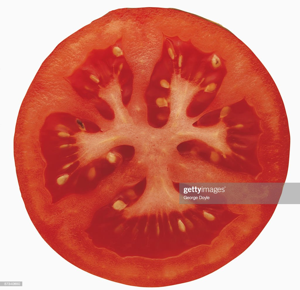 tomatoes sliced in half : Stock Photo
