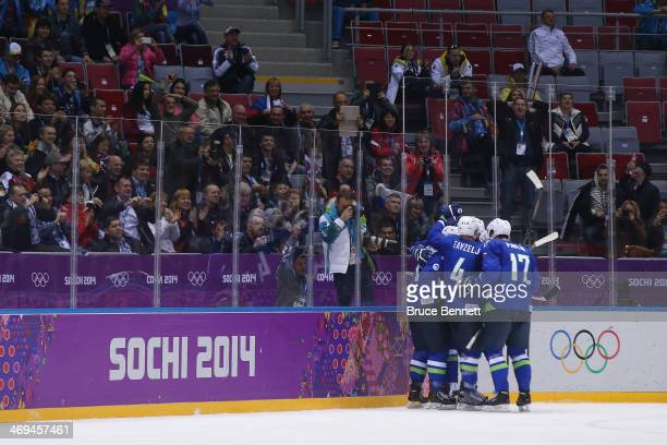 Tomaz Razingar of Slovenia celebrates with teammates after a goal in the third period against Slovakia during the Men's Ice Hockey Preliminary Round...