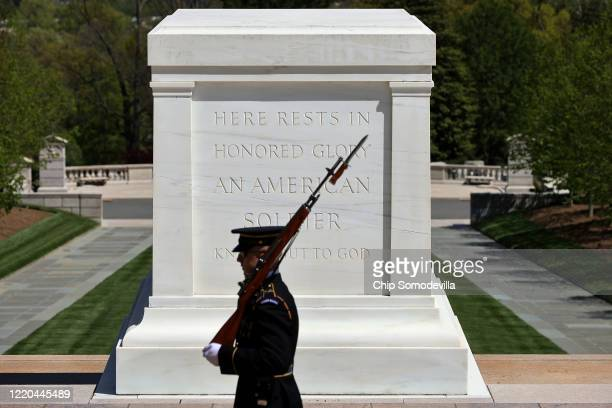 Tomb Guard or Sentinel from the US Army 3rd Infantry Regiment also called The Old Guard marches in front of the Tomb of the Unknown Soldier in...