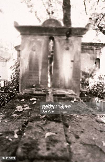 tomb in the pere lachaise cemetery,  paris,  france - crypt stock photos and pictures
