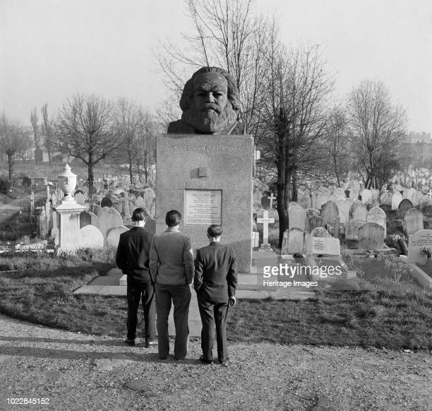 Tomb of Karl Marx Highgate Cemetery Hampstead London circa 1970s Chinese visitors studying the tomb of the German political philospher He was...