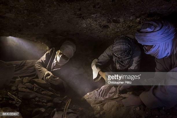 In the tombs of the middle and new kingdom robbers dig and sift large quantities of earth and rubble in search of ancient treasures They work in very...