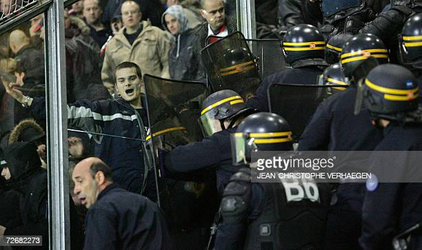 French security forces clash with Feyenoord Rottedam's supporters 30 November 2006 at Marcel Picot Stadium in Tomblaineduring the UEFA cup football...