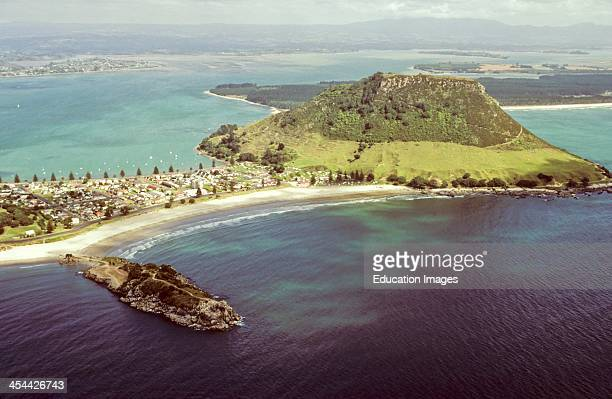 Tombolo deposition landform such as spit or bar forming isthmus between island and shore or 2 islands Mount Maunganui an extinct volcano joined to...