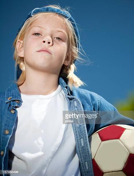 tomboy playing soccer - tomboy stock photos and pictures