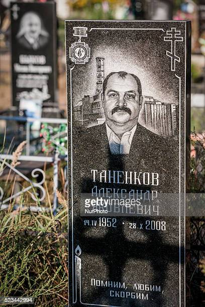 Tombstone engraved with the face of a fireman in the Chernobyl nuclear plant in the cemetery of Slavutich city Ukraine on August 25 2014 The atom...