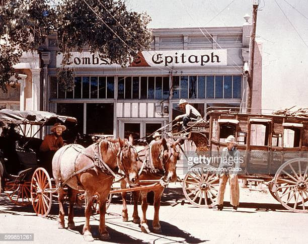 Tombstone Epitaph restaurant, with historical re-enactors driving past in horse drawn stage coaches, Tombstone, Arizona, 1966.