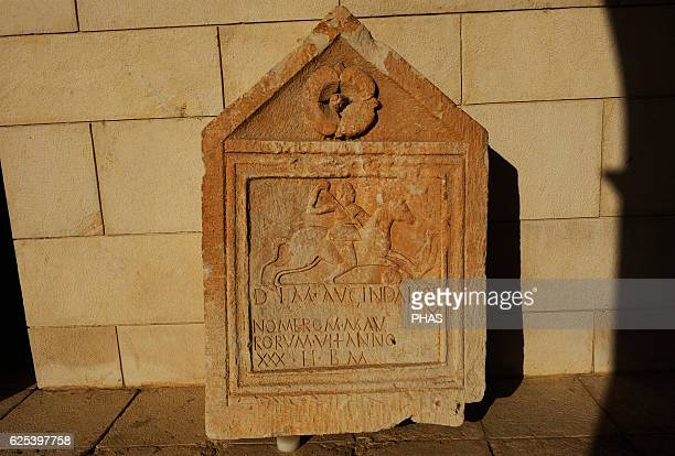 Tombstone limestone Nablus Roman period 2nd3rd century AD The Latin inscription is dedicated to the deified soul of the departed Augindai horseman in...