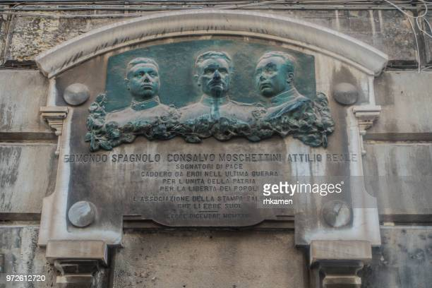 tombstone on palazzo carafa. lecce, salento, apulia, italy. - war memorial stock pictures, royalty-free photos & images