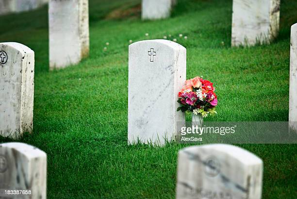 tombstone with flowers - funeral stock pictures, royalty-free photos & images