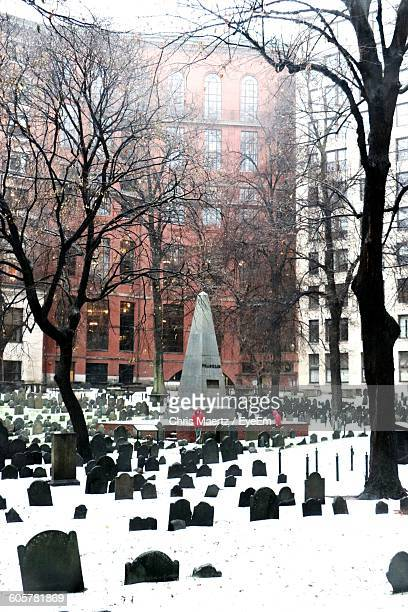 Tombstones And Buildings At Granary Burying Ground During Snowfall