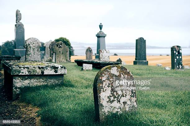 tombstones at cemetery - cemetery stock pictures, royalty-free photos & images