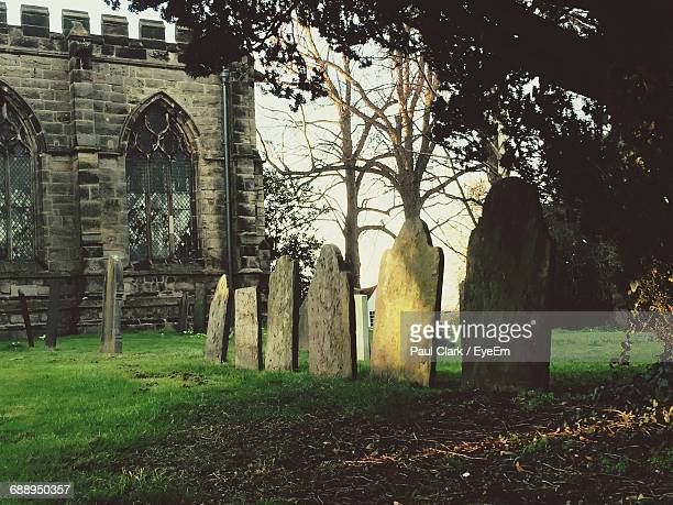 Tombstones At Graveyard By Church