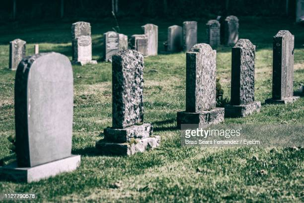 tombstones in cemetery - cemetery stock pictures, royalty-free photos & images