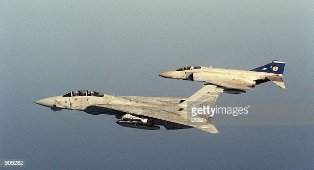 Tomcat aircraft foreground flies a joint patrol with a British Royal Air Force FGR Mark 2 Phantom II aircraft during Operation Desert Shield The VF42...
