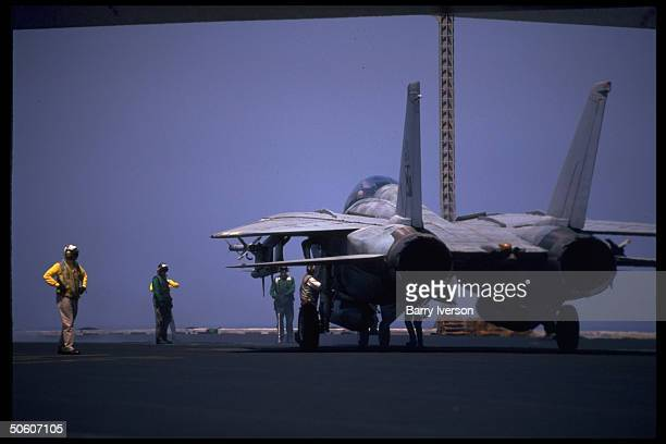 Tomcat fighter plane on deck of US Fifth Fleet flagship aircraft carrier USS Carl Vinson cruising Persian Gulf waters enforcing nofly zone other...