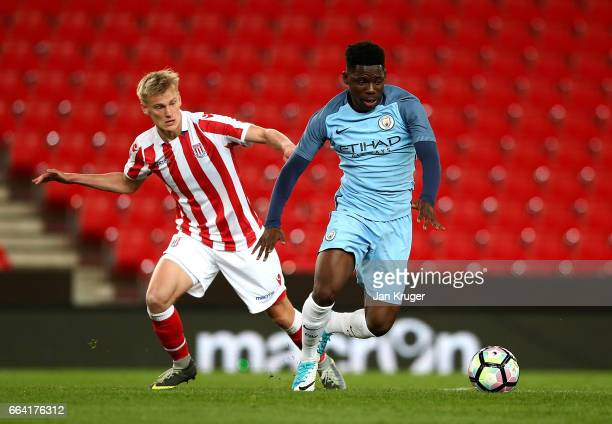 Tome DeleBashiru of Manchester City battles with Lasse Sorensen of Stoke City during the FA Youth Cup Semi Final second leg match between Stoke City...