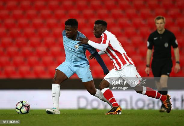 Tome DeleBashiru of Manchester City battles with Rashid Balde of Stoke City during the FA Youth Cup Semi Final second leg match between Stoke City...
