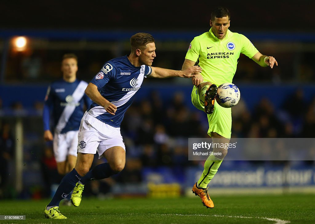 Tomek Hemed of Brighton and Hove Albion is tracked by Michael Morrison of Birmingham City during the Sky Bet Championship match between Birmingham City and Brighton and Hove Albion at St Andrews on April 5, 2016 in Birmingham, United Kingdom.