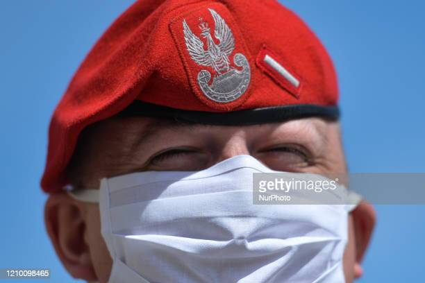 Tomek wears a protective mask while in a street in Krakow. From today until further notice, the Ministry of Health introduced a new rule that...