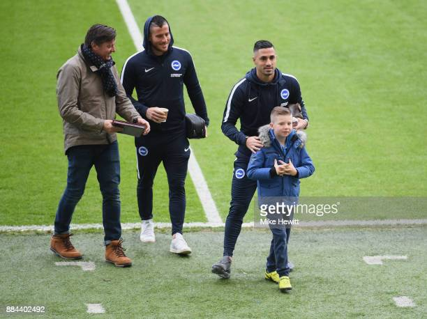 Tomer Hemed of Brighton and Hove Albion and Biram Kayal of Brighton and Hove Albion meet a young Brighton and Hove Albion fan prior to the Premier...