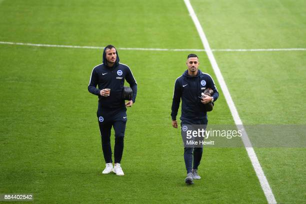 Tomer Hemed of Brighton and Hove Albion and Biram Kayal of Brighton and Hove Albion take a look around the pitch prior to the Premier League match...