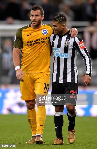 Tomer Hemed of Brighton and Hove Albion and Deandre Yedlin of Newcastle United talk after the Premier League match between Newcastle United and...