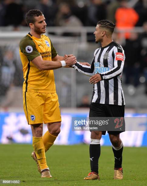 Tomer Hemed of Brighton and Hove Albion and Deandre Yedlin of Newcastle United shake hands after the Premier League match between Newcastle United...